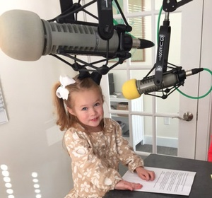 Owner's daughter at the local radio station